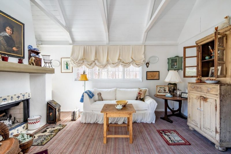 cottage family room with fireplace and balloon valances over window