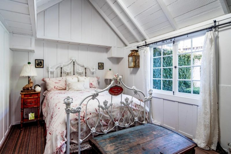 small cottage bedroom with vaulted ceiling