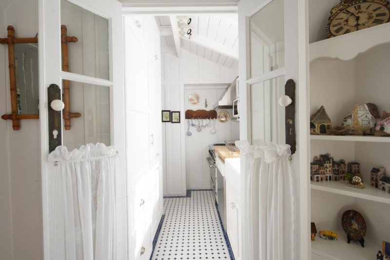 small white kitchen in cottage