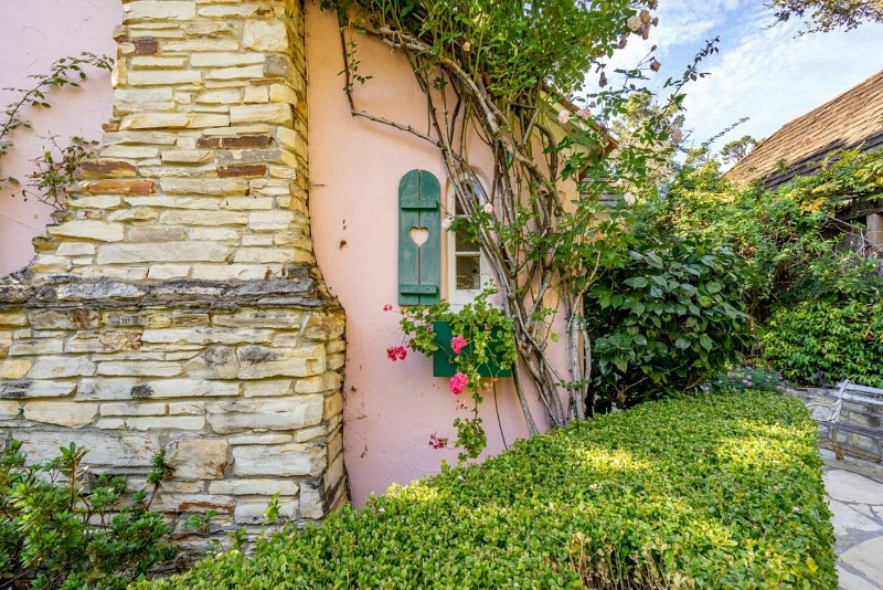 pink cottage with fireplace and shutters