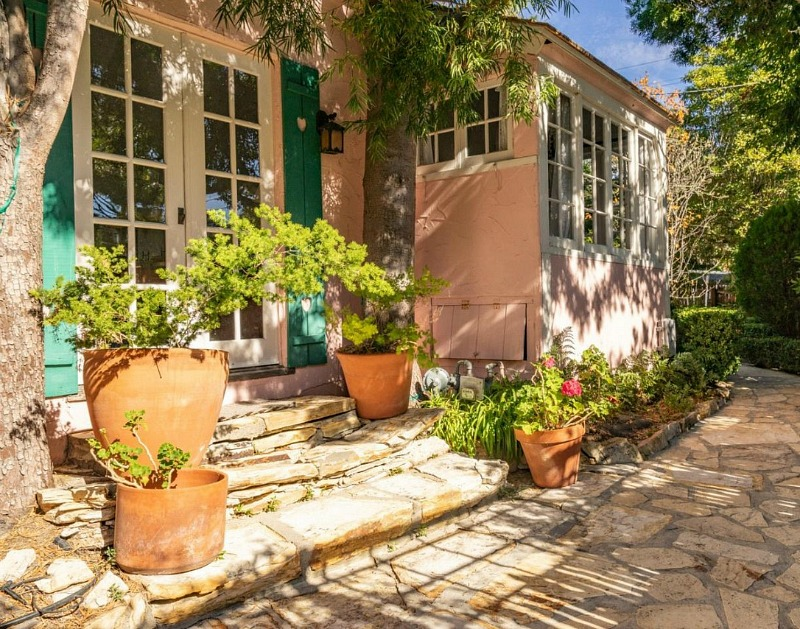 french doors with shutters on pink cottage in Carmel