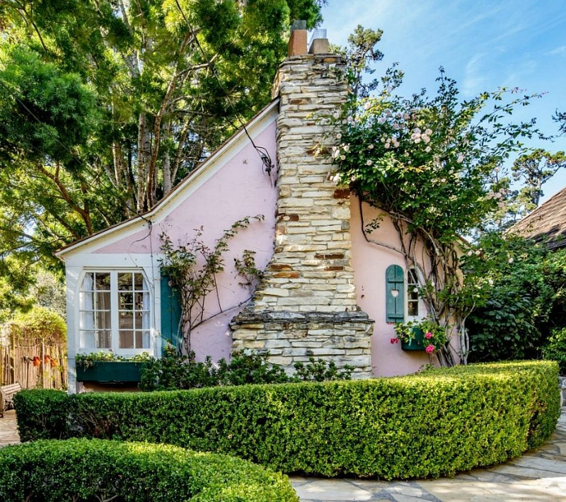 Pink Exterior of Hugh Comstock Cottage For Sale in Carmel-by-the-Sea