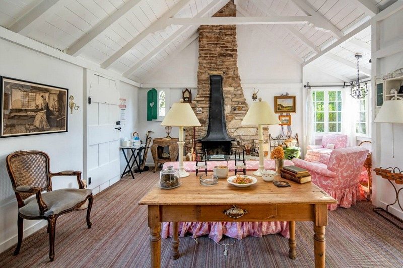 Hugh Comstock Cottage living room with fireplace