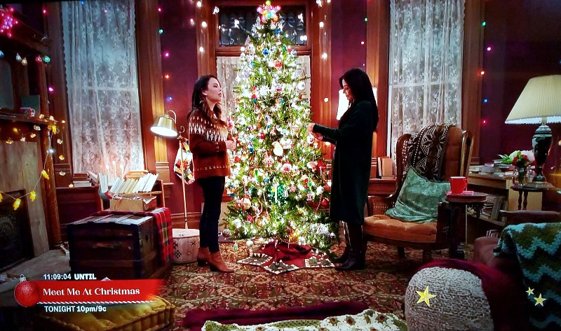 Janel Parrish Marisol Nichols Holly & Ivy living room decorated for Christmas