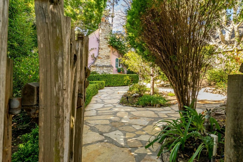 garden gate leading to pink cottage in Carmel