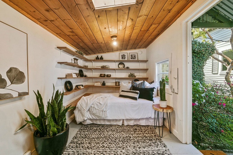 guest cottage bedroom behind small farmhouse