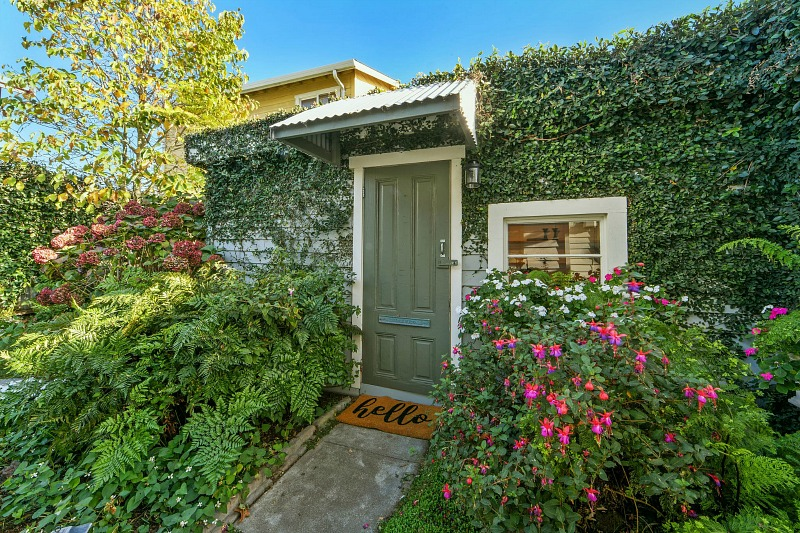 ivy covered guest cottage front door
