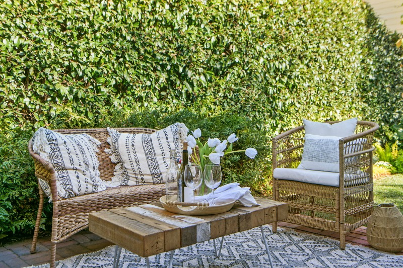 wicker settee and chair on back patio