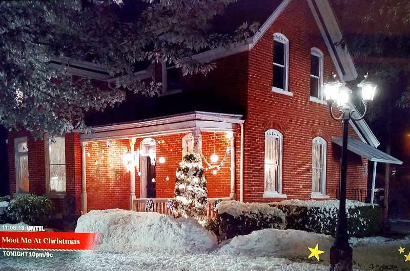 old house in Holly & Ivy movie at night in snow