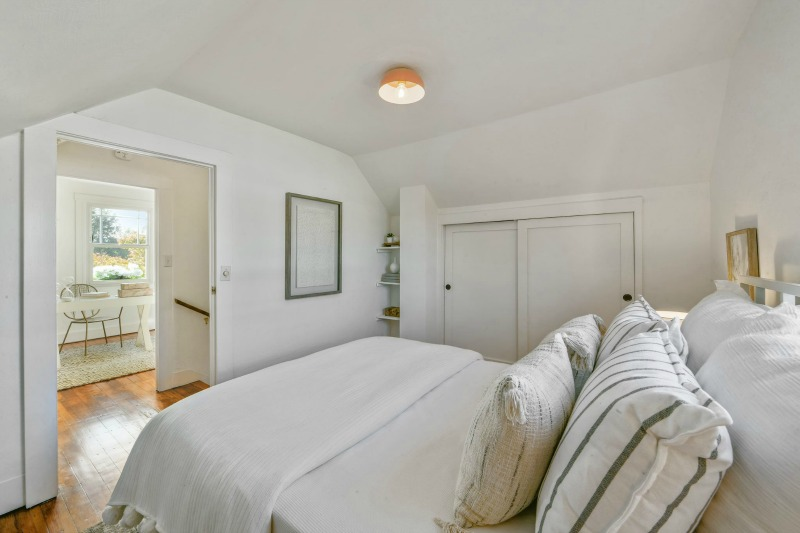 small farmhouse bedroom with white walls