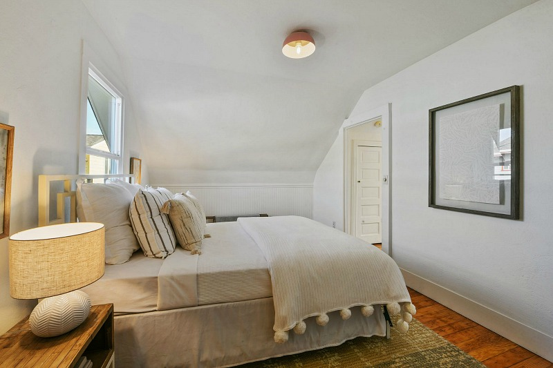 upstairs bedroom with sloped ceiling