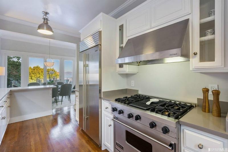 white kitchen stainless steel range